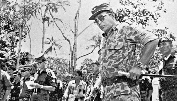 "Lesson learned – Then Maj. Gen. Soeharto (right) leads an operation to remove the bodies of military generals who were killed and dumped into a well at the G30S coup headquarters called ""Lubang Buaya"" in the 1965 incident. (Tempo/-)"